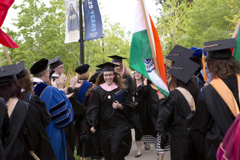 University Awards Degrees to 467 Students at Spring Commencement Ceremonies featured image background