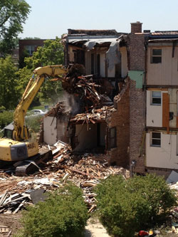Demolition of campus apartments on Christiana Avenue prepares the way for the new Johnson Center for Science and Community Life.