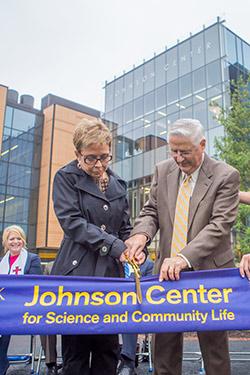 Nancy and Tim Johnson cut the ribbon on the Johnson Center