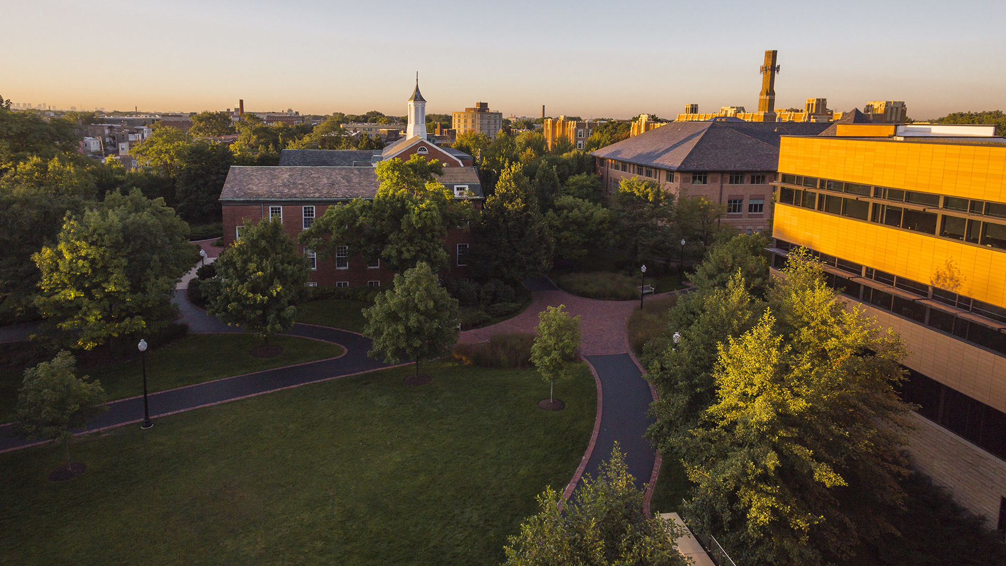 Aerial view of North Park Campus, overlooking greenspace, walkways, and seminary building steeple.
