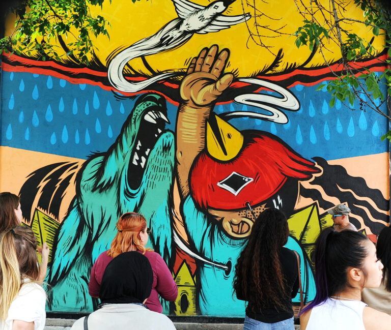 A Catalyst Excursion: Engaging History and Intercultural Context Through Pilsen's Murals featured image background