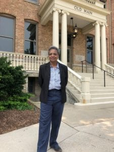 Mayor Lightfoot stands in front of Old Main building