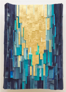 Three-dimensional art piece made out of strips of gold and blue paper.
