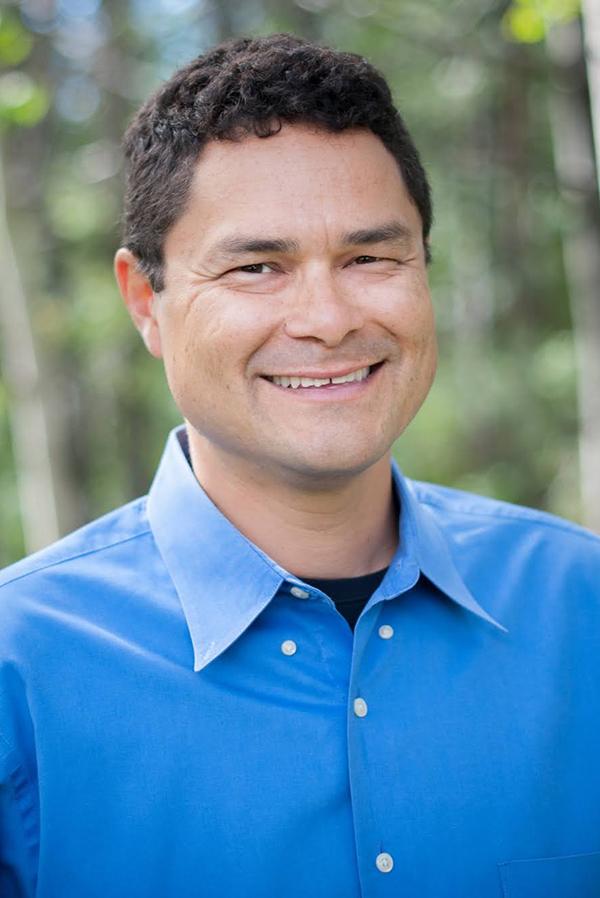 Smiling man in blue dress shirt