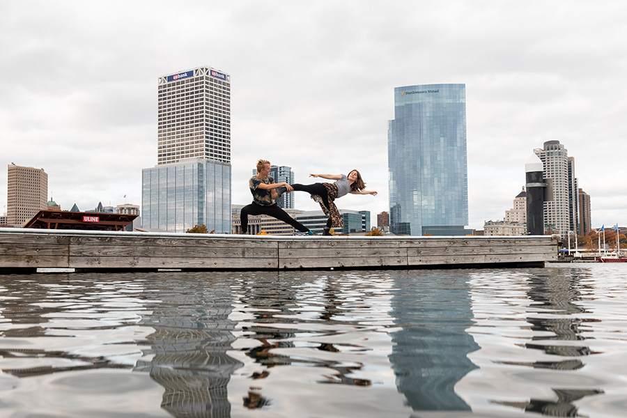 Pair of male and female dancers on a pier in front of Chicago skyline